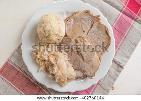 Roasted Pork with bread dumplings and sauerkraut - stock photo