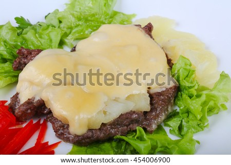 Roasted Pork with pineapple and cheese served salad leaves - stock photo