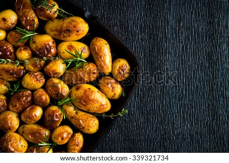 Roasted potato in a frying pan - stock photo