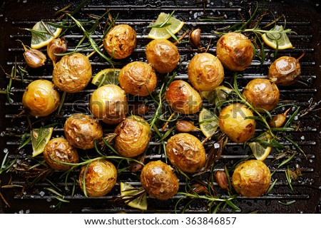 Roast potatoes stock images royalty free images vectors roasted potatoes with rosemary garlic lemon and sea salt on a grilled pan ccuart Image collections