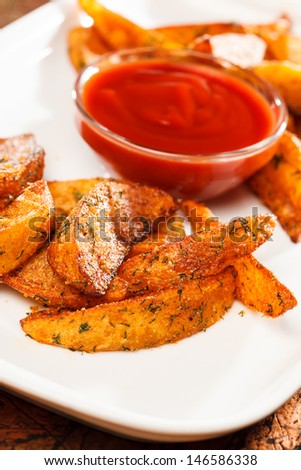 roasted potatoes with sauce - stock photo