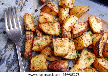roasted potatos and fork - stock photo