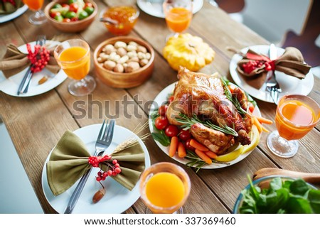 Roasted poultry and other food on Thanksgiving table - stock photo