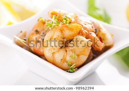 roasted prawns in white plate - stock photo