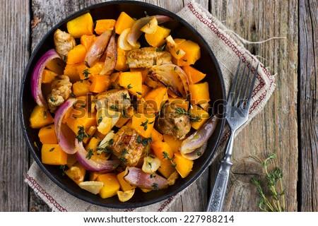 Roasted pumpkin and meat on the pan, top view - stock photo
