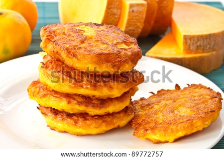 roasted pumpkin pancakes pumpkin pieces on the background - stock photo