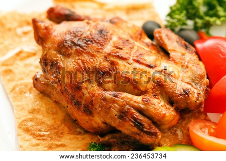 roasted quail with vegetables - stock photo