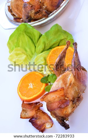 Roasted quails with bacon - stock photo