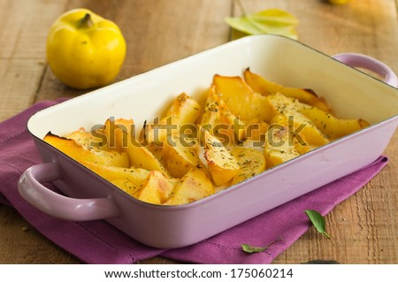 Roasted quinces with Herbes de Provence - stock photo