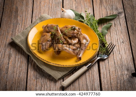 roasted rabbit with herbs and garlic  - stock photo