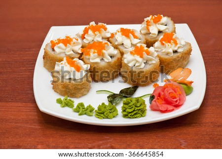 Roasted roll with cream cheese, cucumber and salmon fish - stock photo