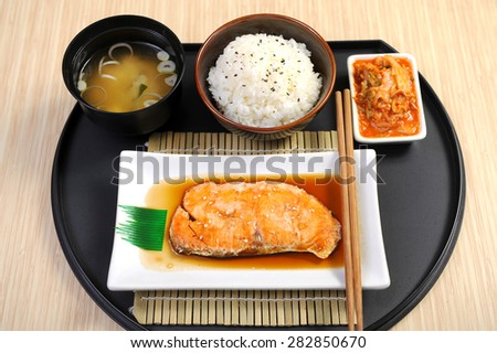 Roasted salmon fillets with rice - stock photo