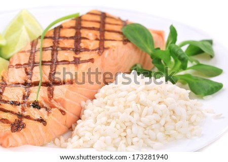 Roasted salmon fillets with rice. Whole background.