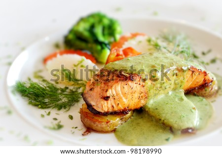 roasted salmon served with green sauce - stock photo