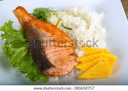 Roasted salmon steak with rice and herbs