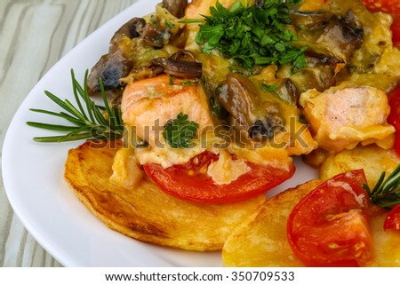 Roasted salmon with cheese, potato and tomato