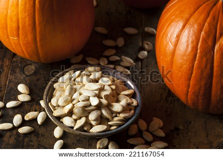 Roasted Salty Pumpkin Seeds Ready to Eat - stock photo