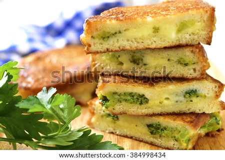 Roasted sandwich with broccoli and cheese on a light background. - stock photo