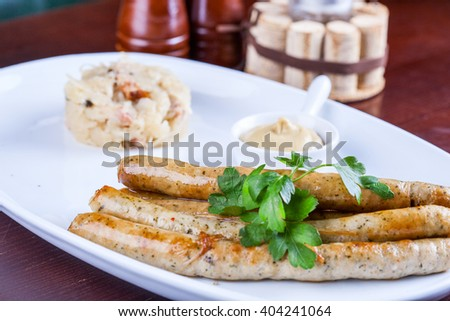 Roasted sausages with mustard - stock photo