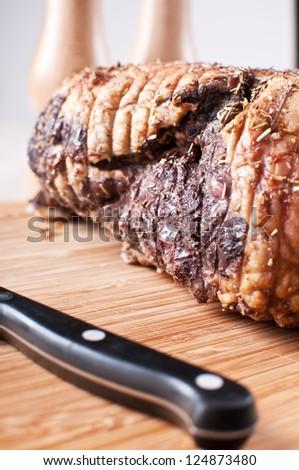 Roasted seasoned lamb leg closeup - stock photo