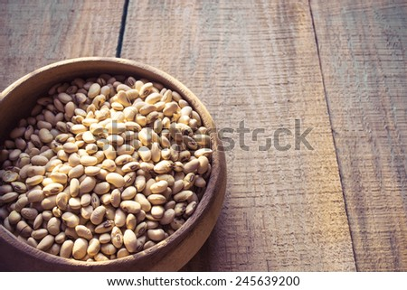 roasted soybeans in wooden bowl - stock photo