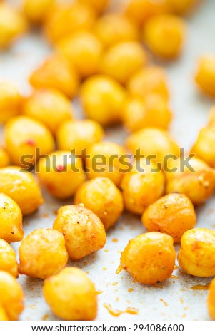 Roasted spicy and crunchy chickpeas healthy snack selective focus - stock photo