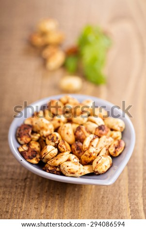 Roasted spicy hot peanuts in small dish - stock photo