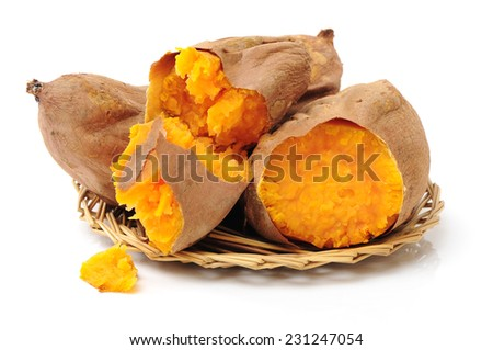 roasted sweet potatoes on a white background  - stock photo