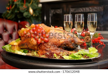 Roasted thanksgiving turkey on restaurant table with champagne - stock photo