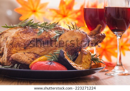 Roasted thanksgiving turkey on restaurant table with wine - stock photo