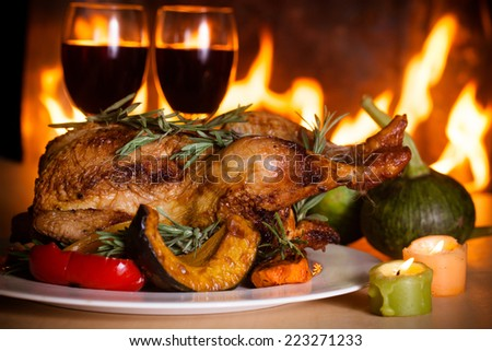 Roasted thanksgiving turkey on restaurant table with wine
