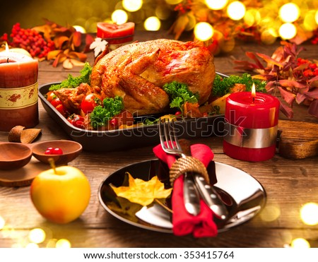 Roasted Turkey. Christmas dinner, table served with turkey, decorated with candles. Roasted chicken, table setting. Christmas dinner  - stock photo