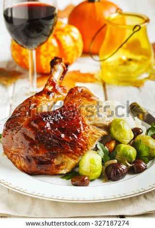 Roasted turkey leg garnished with mash potato, chestnuts and brussels sprouts. - stock photo