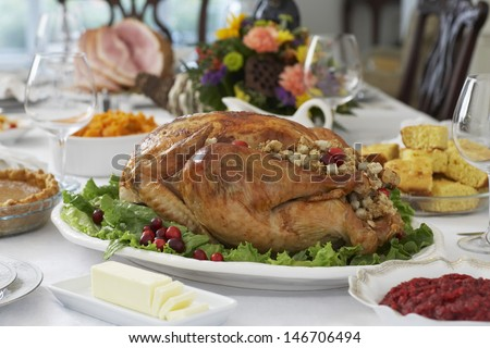 Roasted turkey on table set for Thanksgiving - stock photo