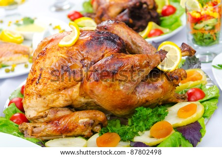 Roasted turkey on the festive table - stock photo
