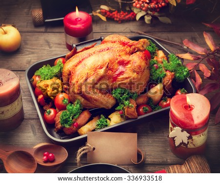 Roasted Turkey. Thanksgiving Dinner. Thanksgiving table served with turkey, decorated with bright autumn leaves. Table setting with greeting card - stock photo