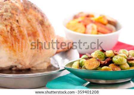 roasted turkey with brussel sprouts and roasted vegetables for a holiday meal - stock photo