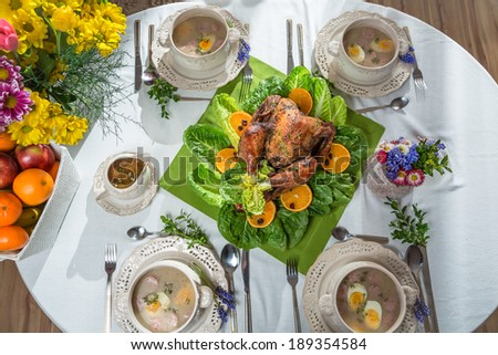 Roasted turkey with oranges served on lettuce served with soup - stock photo
