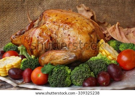 Roasted turkey with vegetables for thanksgiving day - stock photo