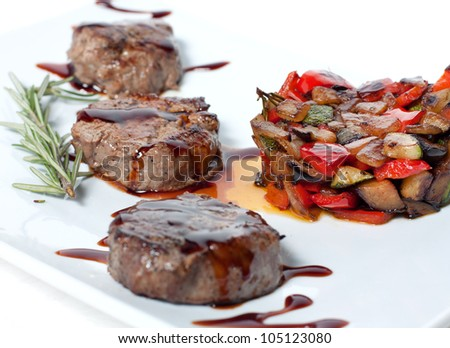 Roasted vegetables and meat with chocolate sauce - stock photo