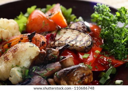 roasted vegetables with mushrooms on black hot pan