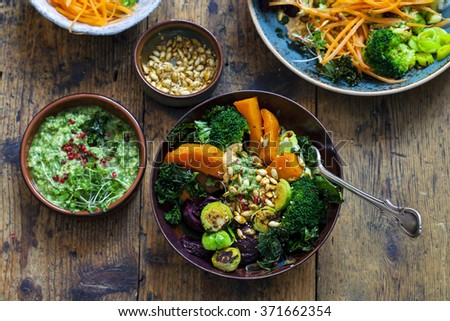 Roasted vegetables with pesto and hummus - stock photo