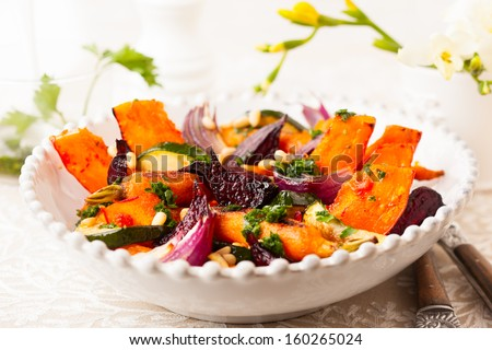 Roasted vegetables with pine nut and  and parsley sauce - stock photo