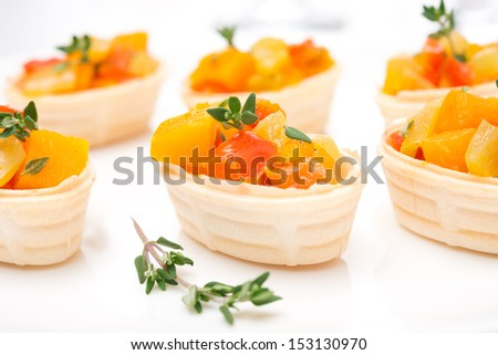 roasted vegetables with thyme in tartlets, close-up, horizontal