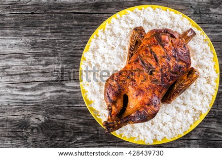 Roasted Whole Duck in honey mustard soy glaze with rice, close-up - stock photo