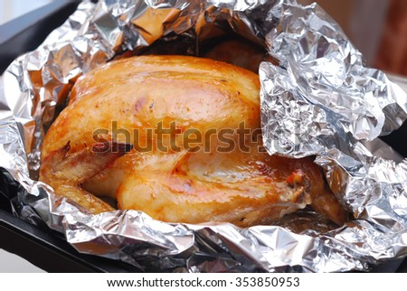 roasting chicken in foil (backed golden chicken on a baking sheet)