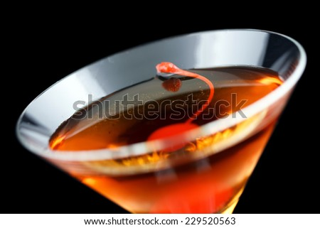 Rob Roy cocktail, consisting of scotch, red vermouth and bitters and garnished with a maraschino cherry