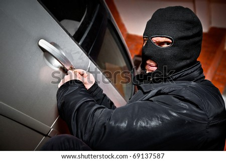 robber and the thief hijacks the car - stock photo