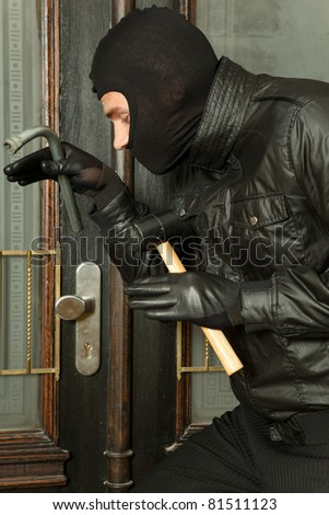 robber at the door - stock photo