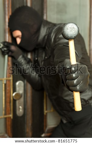 robber at work - stock photo